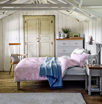 Impello painted bedroom furniture with oak tops