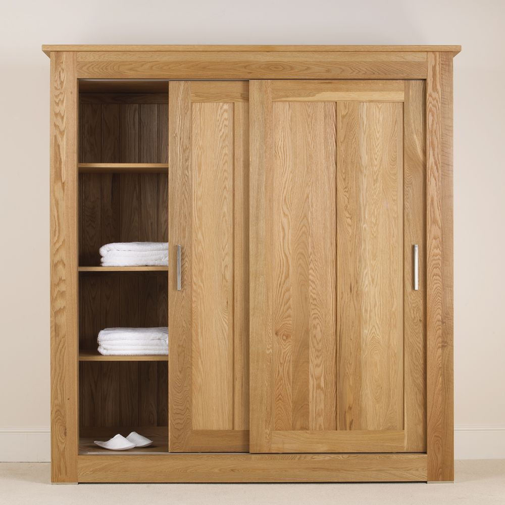 Quercus solid oak sliding door wardrobe con tempo for Door furniture uk