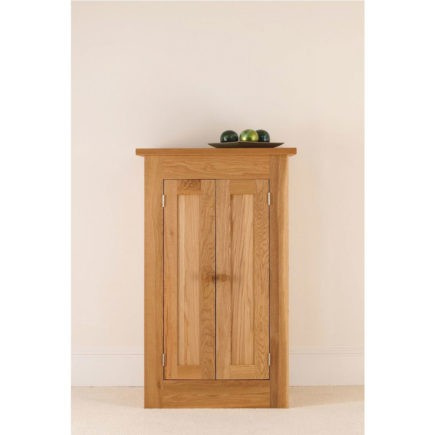 quecus solid oak small panelled cabinet